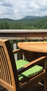 teak table on the patio in the mountains