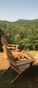 teak adirondack chairs in the mountains